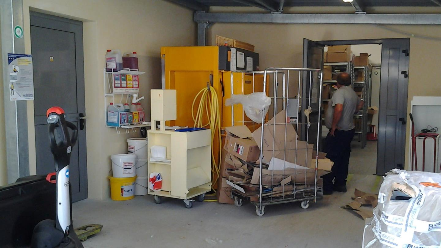 Bramidan X25 cardboard baler placed in a storage room