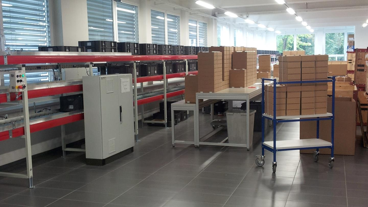 Stacks of cardboard boxes in production hall of Swiss tissot