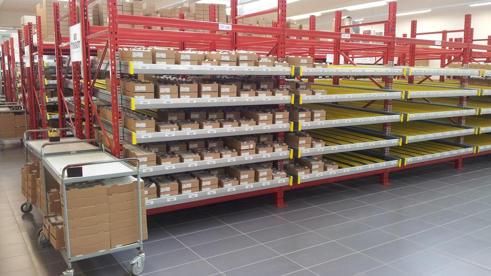 Cardboard boxes with Tissot watches on shelves in the warehouse