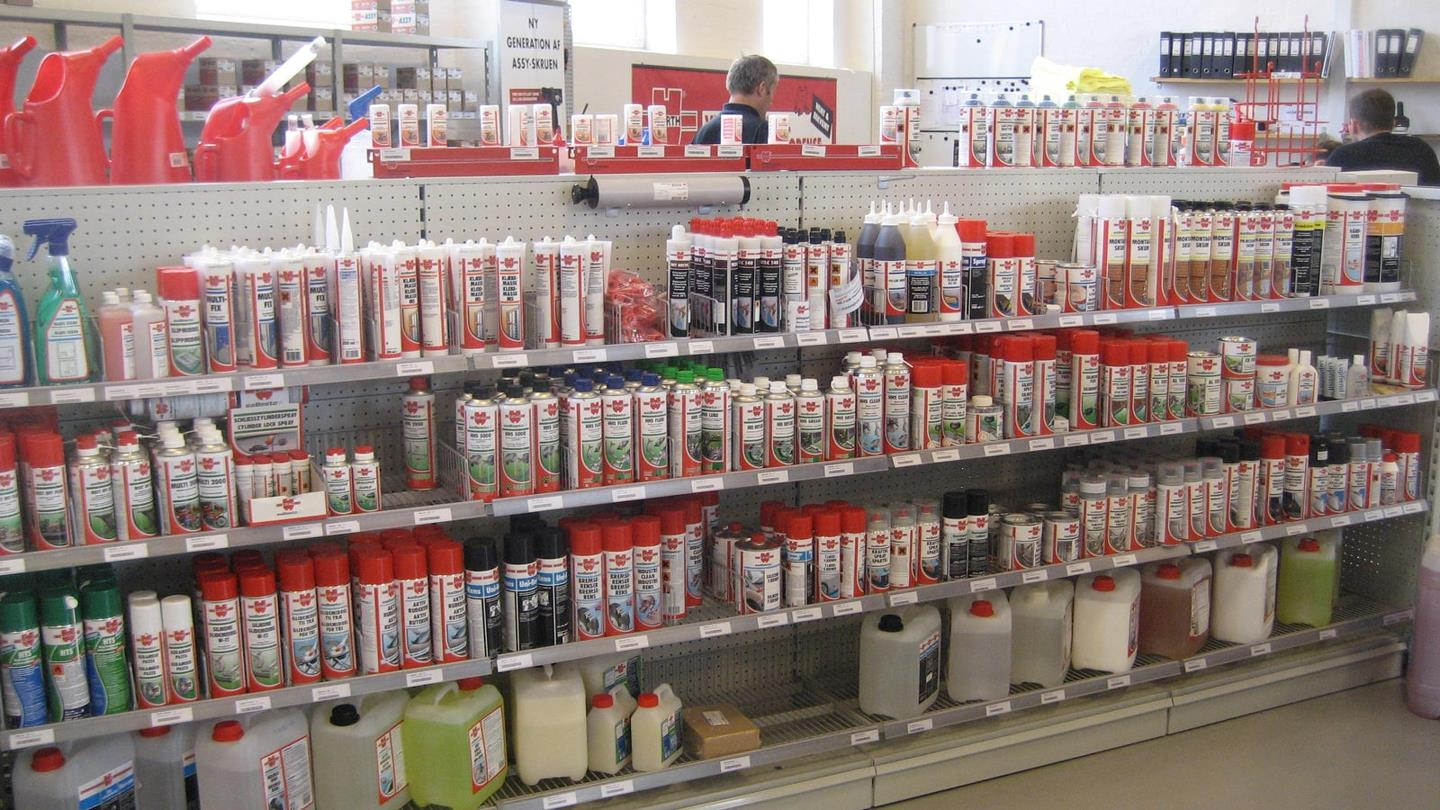 Spray cans and plastic containers on shelves at Würth