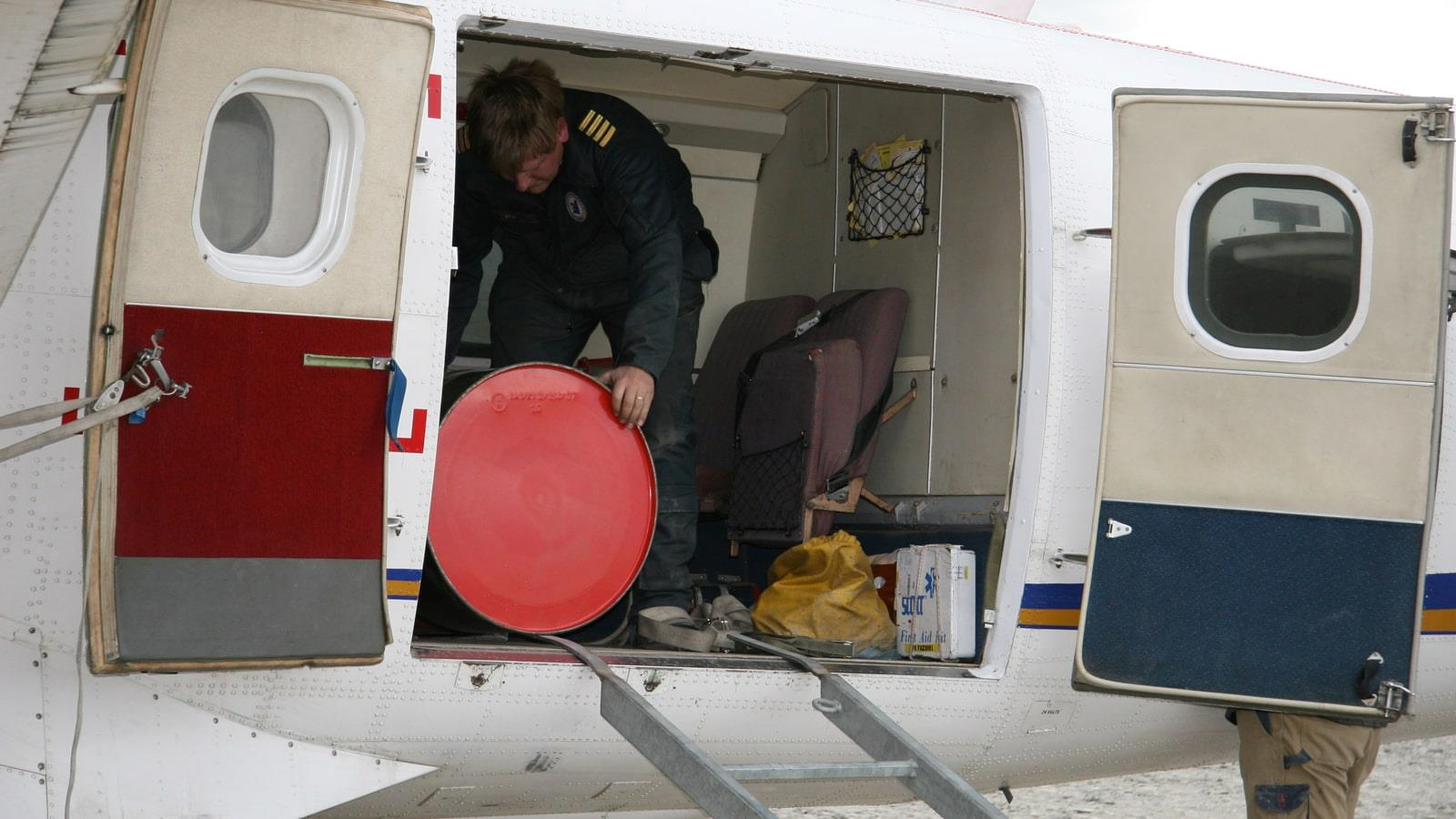 Drum being unloaded from airplane